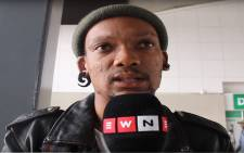 A Johannesburg resident gives his view on whether President Jacob Zuma will resign as the head of state of South Africa. Picture: Kayleen Morgan/EWN