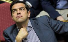 FILE: Former Greek Prime Minister Alexis Tsipras takes part in a session at the Greek Parliament in Athens on 10 July 2015. Picture: AFP.