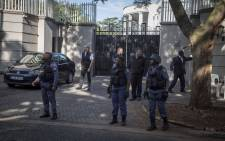 Members of Hawks and SAPS raid the Gupta compound in Saxonwold reportedly making three arrests in connection with the Estina dairy farm project on 14 February 2018. Picture: Thomas Holder/EWN