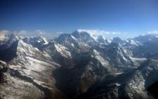 This photograph taken from an aircraft shows an aerial view of Mount Everest (C) and The Himalayan mountain range. Picture:AFP.