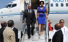President Jacob Zuma steps off the plane with his wife as he arrives for he G20 Summit in Los Cabos, Mexico on 17 June 2012.. Picture: GCIS