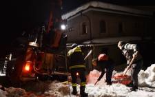 Rescuers clear snow from a hotel buried after an avalanche. Picture: Supplied