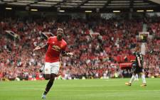 Manchester United's French midfielder Paul Pogba celebrates after scoring their fourth goal during the English Premier League football match between Manchester United and West Ham United at Old Trafford in Manchester, north west England, on 13 August 2017. Picture: AFP.