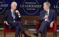 Former US President George W Bush looks on as former president Bill Clinton answers a question at the Presidential Leadership Scholars graduation ceremony at the George W Bush Institute on 13 July, 2017 in Dallas, Texas. Picture: AFP.