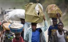 FILE: Villagers flee their homes in Sake, in the Democratic Republic of the Congo's North Kivu province. Picture: United Nations Photo.