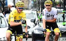 Chris Froome, left, wearing the overall leader's yellow jersey, wins the Tour de France 2017. Picture: Twitter/ @LeTour.