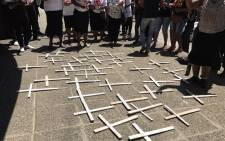 Families and supporters of 37 psychiatric patients who died after being transferred from Life Healthcare Esidimeni gather around white handmade crosses during a march at the Gauteng Health MEC's offices on 27 October 2016. Picture: Masego Rahlaga/EWN.