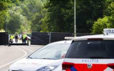 A picture taken near the site of the Pinkpop festival in Landgraaf, on 18 June 2018, shows police cars after a van slammed into pedestrians, killing one and injuring three. Picture: AFP