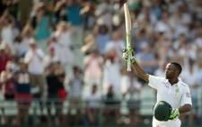 South African batsman Temba Bavuma celebrates after scoring a century (100 runs) during day 4 of the second Test match between England and South Africa at the Newlands stadium on January 5, 2016 in Cape Town, South Africa. Picture: AFP