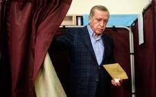Turkish President Recep Tayyip Erdogan exits a voting booth at a polling station in Istanbul on 1 November, 2015. Picture: AFP.