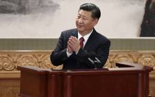 FILE: Chinese President and General Secretary of the Communist Party Xi Jinping applauds as he gives a speech during the introduction of the Communist Party of China's Politburo Standing Committee, in Beijing's Great Hall of the People on 25 October 2017. Picture: AFP.