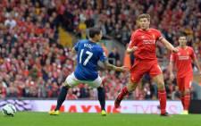 Everton's Bosnian midfielder Muhamed Besic (L) is beaten by Liverpool's English midfielder Steven Gerrard during the English Premier League football match between Liverpool on September 27, 2014. Picture: AFP.