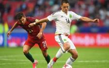 Portugal led but Mexico fought back to earn a point in their Confederations Cup Group A opener. Picture: Twitter @FIFAcom.