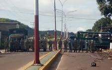 Venezuelan soldiers blocking the access to Puerto Ayacucho jail after a riot on 16 August, 2017 that left -up to now- 37 dead, according to officials. Picture: AFP.