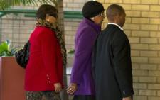 Winnie Madikizela-Mandela (C) arrives on June 10, 2013 with her daughter Zindzi (L) at a Pretoria hospital where her ex-husband, former South African President Nelson Mandela has been hospitalized as a result of recurring lung infection. Mandela remains in a serious but stable condition as he receives intensive care for a recurrent lung infection, the South African government said on June 10. Picture: AFP.