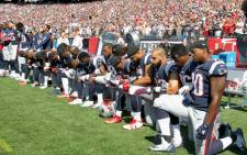 Members of the New England Patriots kneel during the US national anthem before a game against the Houston Texans at Gillette Stadium on 24 September 2017 in Foxboro, Massachusetts. Picture: AFP.