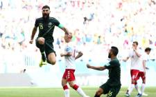 Australia's Mile Jedinak celebrating scoring a goal against Denmark during their World Cup match. Picture: Facebook.com.