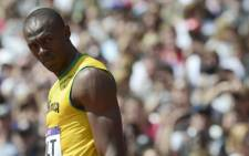 Jamaica's Usain Bolt looks on before competing in the men's 100m heats at the athletics event of the London 2012 Olympic Games on August 4, 2012 in London. Picture: AFP.
