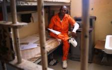 A prisoner at the Pollsmoor prison hits the books. Picture: Bertram Malgas/EWN