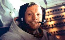 "Apollo 11 space mission US astronaut Neil Armstrong is seen smiling at the camera aboard the lunar module ""Eagle"" on July 21, 1969 after spending more than 2½ hours on the lunar surface. Picture: NASA/AFP."