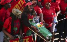 An EFF supporter carries a coffin depicting President Jacob Zuma. Picture: Cindy Archillies/EWN