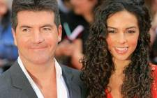 Creator of 'The X Factor' Simon Cowell with actress Terri Seymour. Picture: AFP