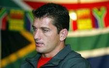FILE: Former Springboks scrumhalf Joost van der Westhuizen talks to the media during a press conference for the Rugby World Cup in Perth on 15 October 2003.  Picture: AFP.