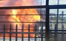 A truck was set alight outside the Albany bakery in Germiston on 26 September 2012, allegedly by striking Satawu workers. Picture: Twitter.
