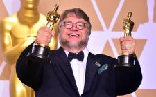 'The Shape of Water' director Guillermo del Toro with his Oscar awards on 4 March 2018. Picture: AFP
