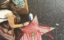 Paris Jackson removing red graffiti that was scribbled on Michael Jackson's Hollywood star. Picture: @parisjackson/Instagram.
