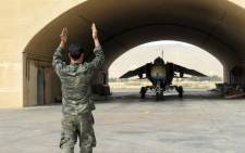 A Syrian army jet is guided out of the hangar at Dmeir military airport, 50 km north-east of Damascus. Picture: AFP.