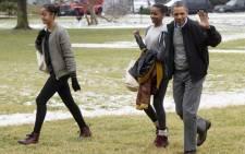 US President Barack Obama and his daughters Malia (left) and Sasha. Picture: EPA.