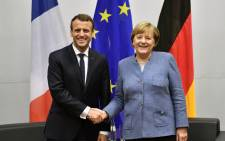 French President Emmanuel Macron (R) shakes hands with German Chancellor Angela Merkel during bilateral talks on the sidelines of the UN conference on climate change (COP23) on 15 November 2017 in Bonn. Picture: AFP