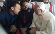 Pope Francis talking to Latam airline flight attendants Paula Podest and Carlos Ciuffardi on the plane, after marrying them during the flight between Santiago and the northern city of Iquique on 18 January 2018. Picture: Osservatore/AFP.