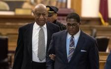 FILE: Bill Cosby (left) is escorted outside Montgomery County Courtroom during a pretrial hearing in his sexual assault trial on 3 April 2017 in Norristown, Pennsylvania. Picture: AFP