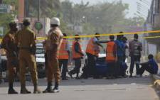 Burkina Faso troops oversee the evacuation of bodies outside the Splendid hotel and the Cappuccino restaurant following a jihadist attack in Ouagadougou on 16 January 2016. Picture: AFP.