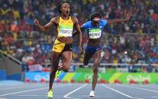 Jamaica's Elaine Thompson (L) reacts as she crosses the finish line next to bronze medallist USA's Tori Bowie to win the Women's 200m Final at the Rio 2016 Olympic Games at the Olympic Stadium in Rio de Janeiro on August 17, 2016. Picture: AFP