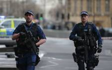FILE: Armed British police patrol outside the Houses of Parliament in Westminster following a terrorist attack on 22 March, 2017. Picture: AFP