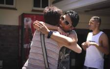 The mother of a Westerford Matric pupil, Estelle Cloete hugs another mother at the school. The school achieved a 100% pass rate. Picture: Cindy Archillies/EWN