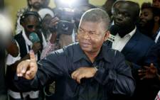 MPLA (The People's Movement for the Liberation of Angola) presidential candidate Joao Lourenco shows his inked finger after voting in Luanda, on 23 August 2017 during the general elections. Picture: AFP.