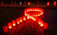 Candles form a red ribbon during World Aids Day. Picture: AFP.
