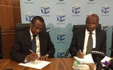 IEC Chief Electoral Officer Mosotho Moepya (right) has encouraged South Africans to come out in their numbers this weekend to register for the upcoming local government elections. Picture: Vumani Mkhize/EWN.