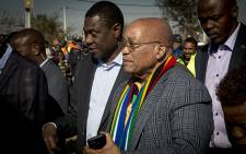 President Jacob Zuma walks next to Gauteng ANC chairperson Paul Mashatile in Thembelihle south of Johannesburg during the ruling party's campaign trail on 30 June 2016. Picture: Reinart Toerien/EWN.