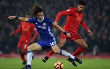 Chelsea defender David Luiz (L) vies with Liverpool's midfielder Emre Can during the English Premier League football match between Liverpool and Chelsea at Anfield in Liverpool, north west England on January 31, 2017. Picture: AFP