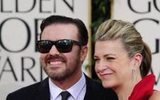 Actor Ricky Gervais and producer Jane Fallon arrive at the 68th annual Golden Globe awards. Picture: AFP