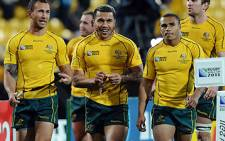 Wallabies fly-half Quade Cooper, wing Digby Ioane and scrum-half Will Genia celebrate after the 2011 Rugby World Cup quarter-final match on 9 October. Picture: AFP