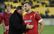 FILE: New Zealand head coach Steve Hansen (L) talks with former Wales captain Sam Warburton (R) after the rugby Test match between the New Zealand All Blacks and Wales in Wellington on 18 June 2016.  Picture: AFP.