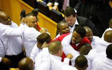 Security officials remove the EFF's Mbuyiseni Ndlozi from the National Assembly along with other party members after they disrupted President Zuma's 2017 State of the Nation Address. Picture: AFP.