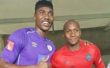 Baroka FC's Oscarine Masuluke being congratulated by his Orlando Pirates counterpart Jackson Mabokgwane. Picture: @Baroka_FC.