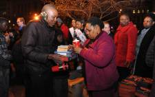 Deputy Minister of Women, Children and People with Disabilities Hendrietta Bogopane-Zulu is seen spending her 67 minutes handingover food and blankets to people on the streets of Pretoria,Tuesday evening, 17 July 2012 ahead of Nelson Mandela Day. People will give 67 minutes of their time today on Madiba's birthday to make the world a better place. Picture: GCIS
